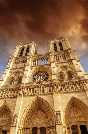 Clouds above Notre Dame Cathedral in Paris photo