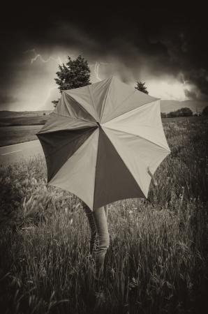 Woman with colorful Umbrella in Tuscany Spring Countryside photo