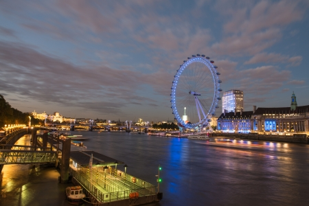 London Skyline at dusk from Westminster Bridge with illuminated London Eye - UK