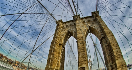 Magnificient structure of Brooklyn Bridge - New York City - USA photo