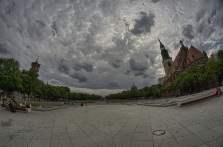 Alexanderplatz, wide angle with with cloudy summer sky - Berlin, Germany