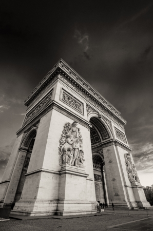 Dramatic Sky above Triumph Arc in Paris with Sunset Colors, France