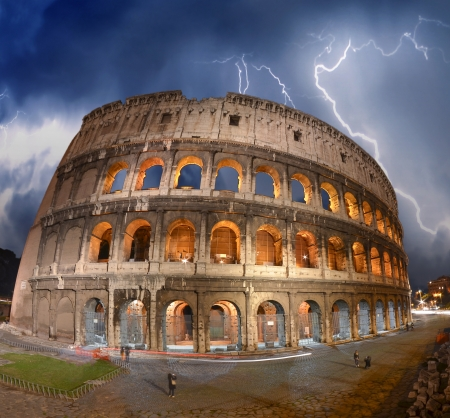 amphitheatre: Beautiful dramatic sky over Colosseum in Rome  Stock Photo