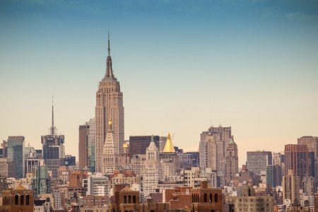 historic place: Buildings and Skyscrapers of Manhattan with Dramatic Sky, U S A  Stock Photo