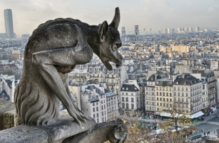 Paris. Closeup of gargoyle on the top of Notre-Dame Cathedral - City View. photo