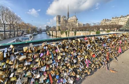 PARIS - DEC 1: Lockers at Pont des Arts symbolize love for ever, December 1, 2012 in Paris. 16000 lockers of loving couples are on that bridge, also known as Passarelle des Arts