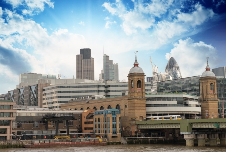 City of London with clouds, financial center and Canary Wharf at the background - UK photo