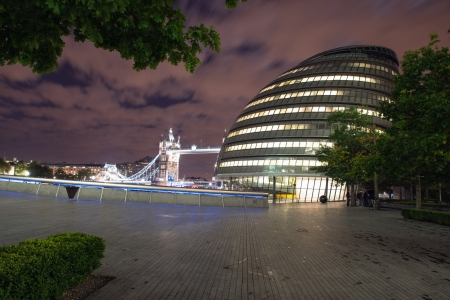 LONDON, SEP 28: London City Hall, headquarter of London Authority and Tower Bridge on September 28, 2012 in London.City Hall is the headquarters of the Greater London Authority (GLA).