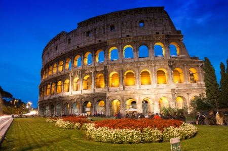Beautiful view of Colosseum at sunset with flowerbed in foreground - Rome - Italy photo