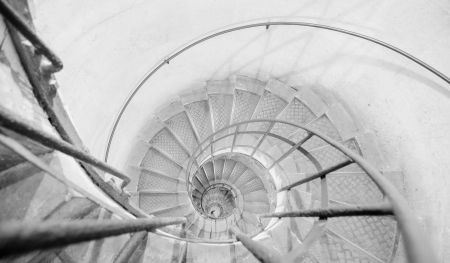 Upside view into the spiral staircase in France photo