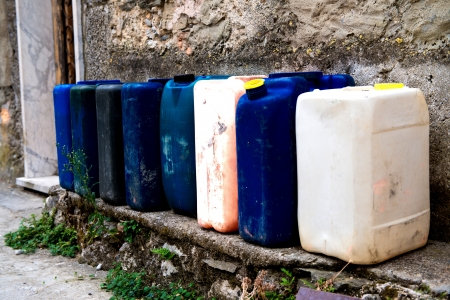 Row of colorful Jerry Cans on the street photo