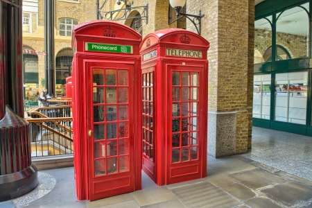 Classic Red Telephone Booth on a street of London - UK