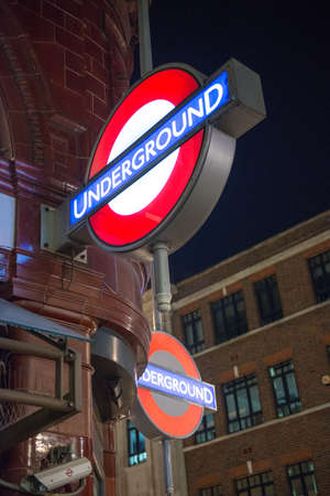 LONDON – SEP 27: Close up of two traditional station signs for the London Underground transportation systems on September 27, 2012 in London. The sign was first used in 1908 Stock Photo - 17003678