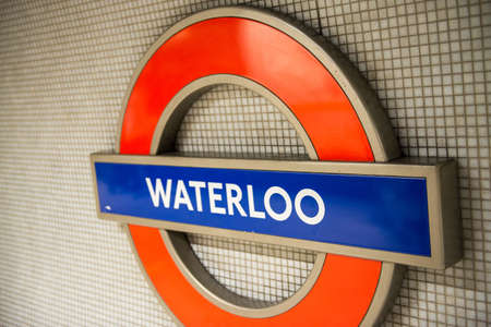 LONDON - SEP 27: Waterloo  underground tube station sign shines on September 27, 2012 in London, England. London's underground railway is the oldest in the world, dating back to 1863 Stock Photo - 17003659
