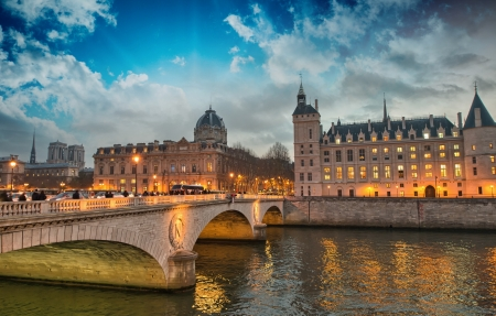 Beautiful colors of Napoleon Bridge at dusk with Seine river - Paris  photo