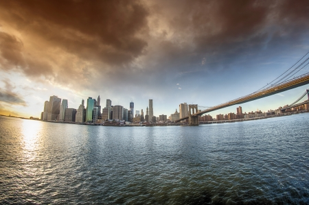 Spectacular view of Brooklyn Bridge from Brooklyn shore at winter sunset - New York City Stock Photo - 17125756