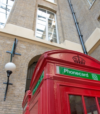 Red Telephone Booth on a classic London Street - UK photo