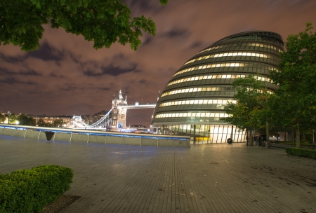 LONDON,  London City Hall, headquarter of London Authority and Tower Bridge on  in London City Hall is the headquarters of the Greater London Authority  GLA