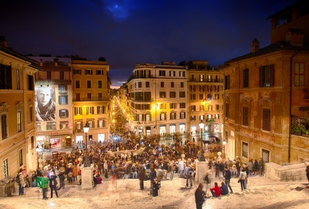 Spagna: ROME -  People climb the spanish steps of Piazza di Spagna on the evening in Rome  Editorial