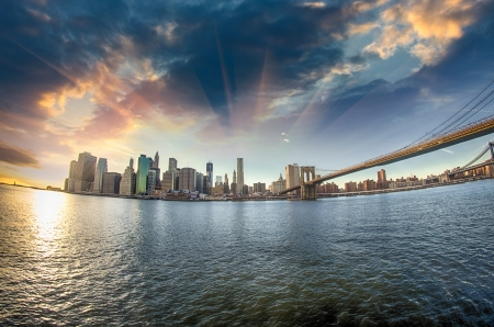 Spectacular view of Brooklyn Bridge from Brooklyn shore at winter sunset - New York City Stock Photo - 17622923