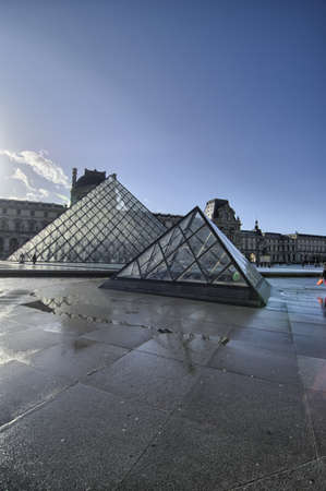 louvre pyramid: PARIS - NOV 27  Louvre Pyramid shines at sunrise on November 27th, 2011 in Paris  Louvre is the biggest Museum in Paris displayed over 60,000 square meters of exhibition space Editorial