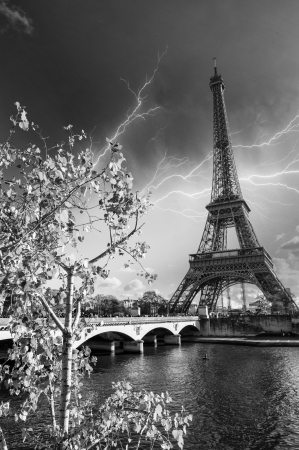 Beautiful colors and vegetation near Eiffel Tower and Seine river - Paris with storm. photo