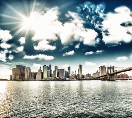 brooklyn: New York City  Wonderful sunset view of Brooklyn Bridge and Manhattan Skyline - USA
