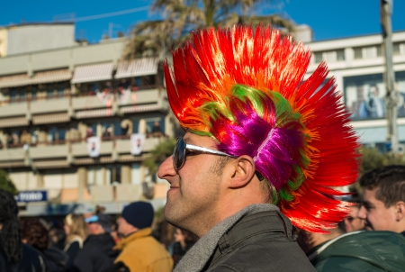 VIAREGGIO, ITALY - FEB 10: The parade of carnival floats, February 10, 2013. The masks depict caricatures of popular people, such as politicians, showmen and sportsmen.