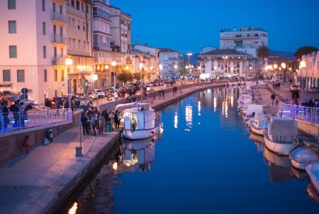 viareggio: Sunset in Viareggio, Italy. Beautiful promenade with channel and boats.