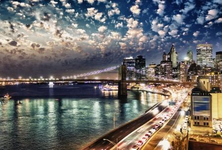 Amazing night in New York City - Manhattan Skyline and Brooklyn Bridge  Stock Photo