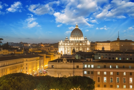 Buildings of Rome with Vatican St Peter Dome in background - sunset view