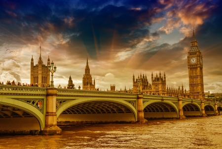 england politics: London, UK - Palace of Westminster (Houses of Parliament) with Big Ben clock tower and Westminster bridge over Thames river at sunset.