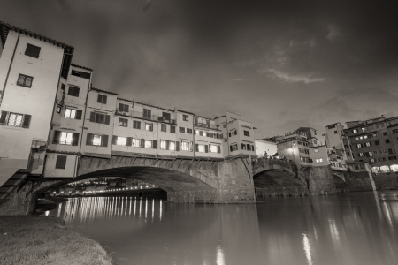 Florence, Italy  Wonderful sunset above Magnificent Ponte Vecchio - Old Bridge view from Arno river bank  photo