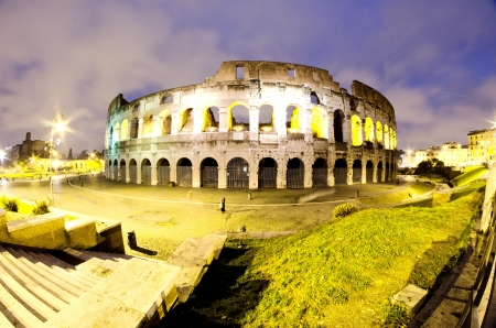 Lights of Colosseum at Night, Italy photo