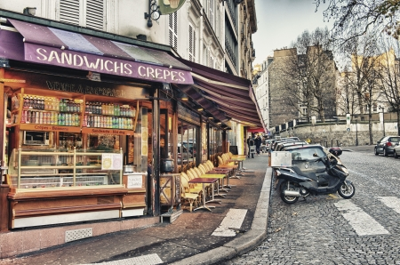 parisian scene: PARIS - DEC 2  Tourists in the beautiful streets of Montmartre, December 2, 2012 in Paris  More than 40 million people visit the city every year  Editorial