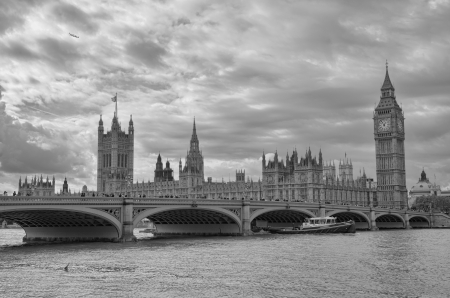 London, UK - Palace of Westminster (Houses of Parliament) with Big Ben clock tower and Westminster bridge over Thames river. photo