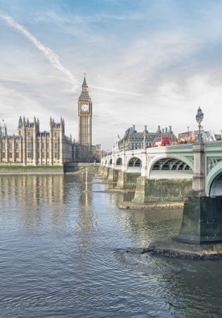 London  Beautiful wide angle view of Houses of Parliament, Big Ben and Westminster Bridge  photo