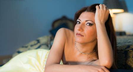 Beautiful woman thinking on a luxury room  photo