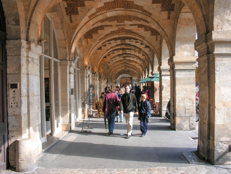 hugo: PARIS - OCT 3  Tourists walk in Place des Vosges, famous city square, October 3, 2007 in Paris  More than 50 million people visit the city every year