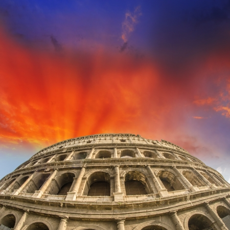 Beautiful sunset sky colors over Colosseum in Rome  Roma - Colosseo photo