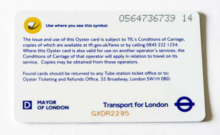 fined: LONDON - SEP 28  A TFL Oyster Card, September 28, 2012 in London  About 4 million travelers a year are being incorrectly fined for not touching their Oyster cards in or out properly