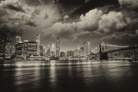 Spectacular sunset view of lower Manhattan skyline from Brooklyn Bridge Park. photo