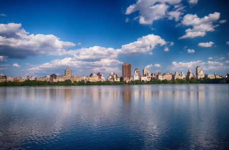 New York City - Panoramic view of modern buildings from Central Park with Jacqueline Kennedy Onassis Reservoir. photo