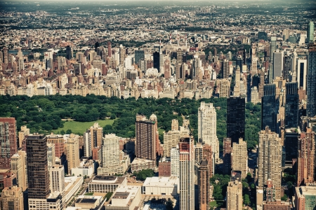 Panoramic Helicopter view of Central Park South and surrounding Skyscrapers, New York City. photo