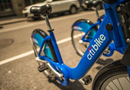 shared sharing: NEW YORK - JUN 11: Citi bike station open for business in New York on June 11, 2013. NYC bike share system hit the road in Manhattan and Brooklyn on May 27, 2013.