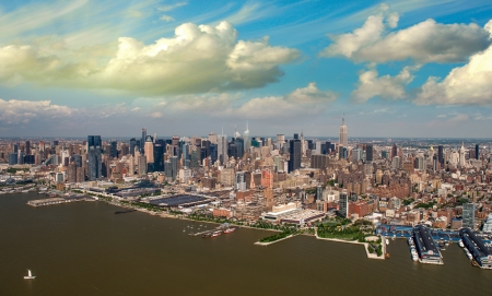 intrepid: Chelsea and Greenwich Village Helicopter view at summer sunset - New York City. Stock Photo