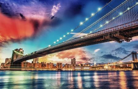 Wonderful panoramic sunset with Brooklyn and Manhattan Bridge - New York.