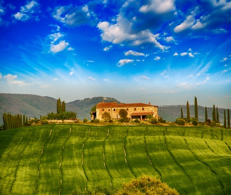 agriturismo: Italian landscape. Tuscany fields and meadows in spring season. Stock Photo