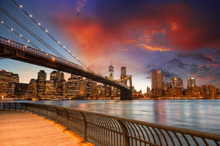 Brooklyn Bridge Park, New York City. Spectacular sunset view of the bridge and Manhattan skyline.