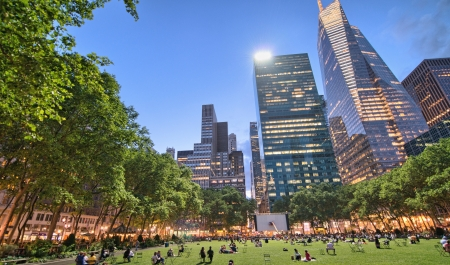 People enjoying a nice evening in Bryant Park in New York City photo